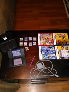 Nintendo Ds and 13 games, carry case, charger and styles.
