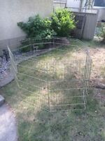 Portable metal dog cage with gate.