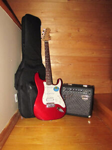 Fender Squire Stratocaster, soft Fender case, and Fender amp