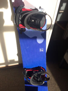 Snowboard, shoes and helmet