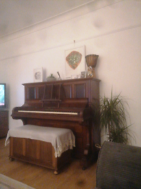 Upright piano with stall