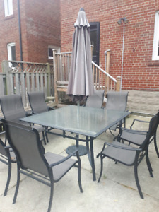 Patio set table, chairs, umbrella, and base