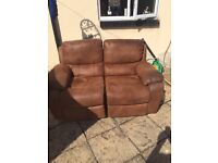 Harvey's faux suede recliner sofa. Offers considered