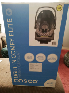 Brand new baby car seat in box with base for car installation.