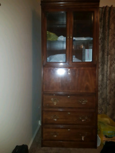 Two nice wooden storage cupboards.