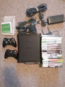 Xbox 360 with 2 controlers and 20 games