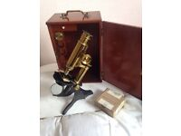 A real antique brass microscope in case
