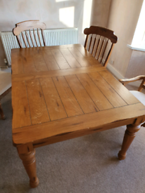 Extending wooden table with 6 chairs