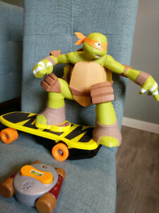 Children remote controlled ninja turtle skate boarder .