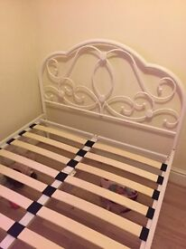 Small double metal frame bed