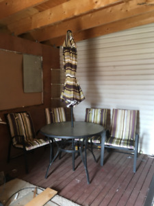 FOR SALE PATIO TABLE WITH THE UMBRELLA AND 4 CHAIRS