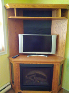 Oak finished electric fireplace/tv cabinet.