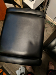 Two gaming chairs with speakers in the seats