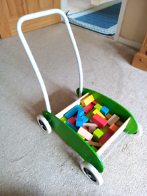 Wooden trolley with colourful wooden bricks