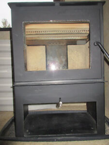Almost new woodstove for sale