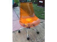 Orange swivel office chair
