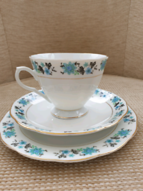 Blue and black floral china trio