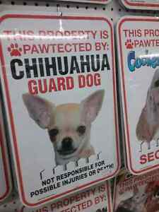Pet signs at One Of A Kind Antique Mall open daily