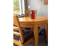 Pine circular table & 2 chairs