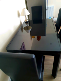 Extendable Black Glass dinning table with four chairs..