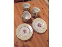 Beautiful tea set (6 cups, 5 saucers, 4 plates)