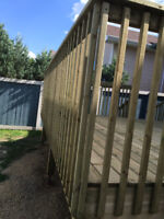 We build good wood fence and DECKS constructionWood fence brown