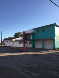 Two bay auto electrical shop including two dwellings