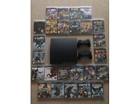 PlayStation 3 (PS3 Slim) with 26 games for sale! Mint Condition!