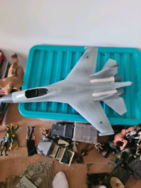 Box of world peacekeeper army figures with jet