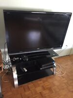 """Sony Bravia 52"""" Black television with table set."""