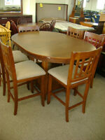 NEW bar height table and SIX chairs. $999.