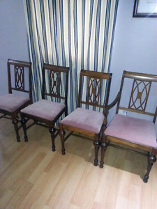 4 Antique solid wood chairs, one is a captiin chair.