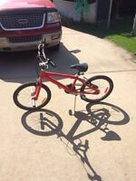 BMX bike with breaks and pegs
