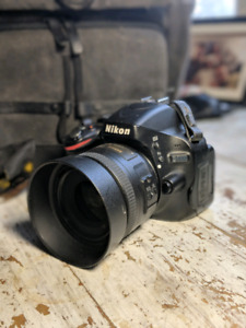 Nikon D5100 DSLR with 35mm lens and National Geographic backpack