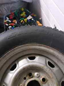 Studded Winter Tires 215/70R14 on 5 bolt Ford rims Prince George British Columbia image 5