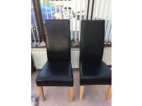 4 Black leather dining chairs