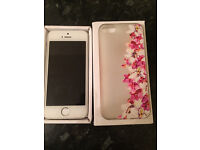 I phone 5s. 16gb. Unlocked. White and silver