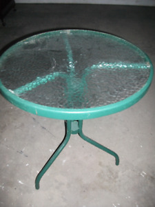 Green table with glass top $35 can be used indoors or out