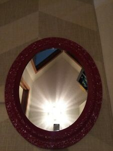 Red oval mirror