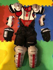 Bauer size small and med hockey equipment kit.