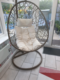 Egg chair with cushions