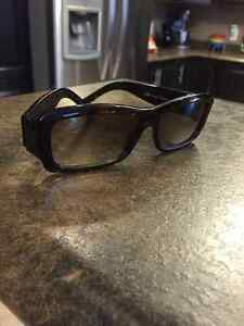 Ladies brown Gucci sunglasses.