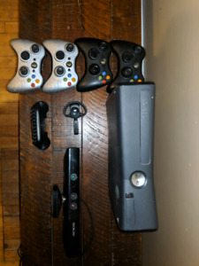 Xbox 360 with 3 controllers, a headset, keyboard and 26 games.
