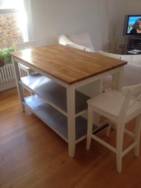kitchen island table with storage and 4 chairs in