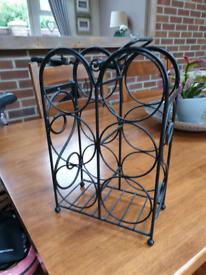 Small ornate metal wine rack
