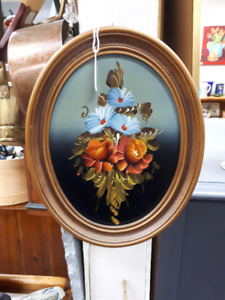 antique oval paintings.