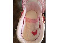 Pink Moses basket and white rocker stand