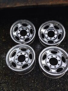 Four Ford wheels in good shape,
