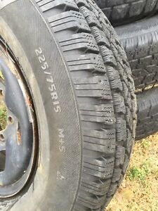 Rim 15s off a Toyota pickup w/used winter tires