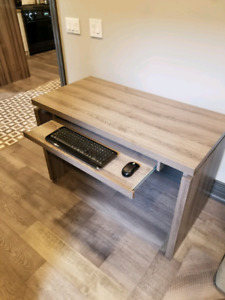 Modern work desk, slightly used Grey wood